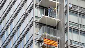 Workers removing glass panels from the balconies of a Lanterra condominium at the corner of Bay and Grosvenor Sts. in downtown Toronto.