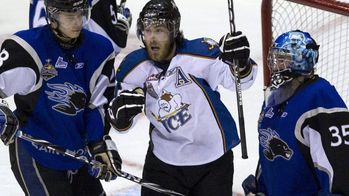 Saint John Sea Dogs goaltender Alexandre Theriault (right) and forward Nathan Beaulieu (28) react as Kootenay Ice forward Kevin King (centre) celebrates his goal during second period Memorial Cup action in Mississauga, Ontario, on Tuesday, May 24, 2011. THE CANADIAN PRESS/Frank Gunn