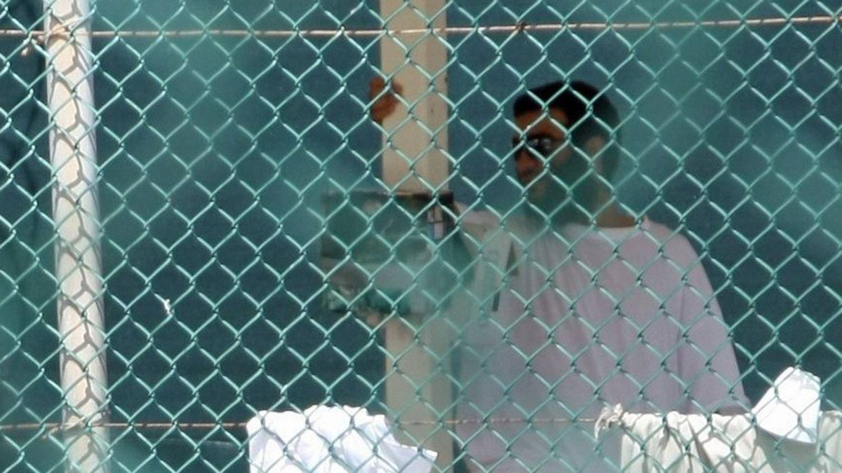 Omar Khadr is seen through the fence at the U.S. detention centre in Guantanamo Bay's on Oct. 23, 2010.
