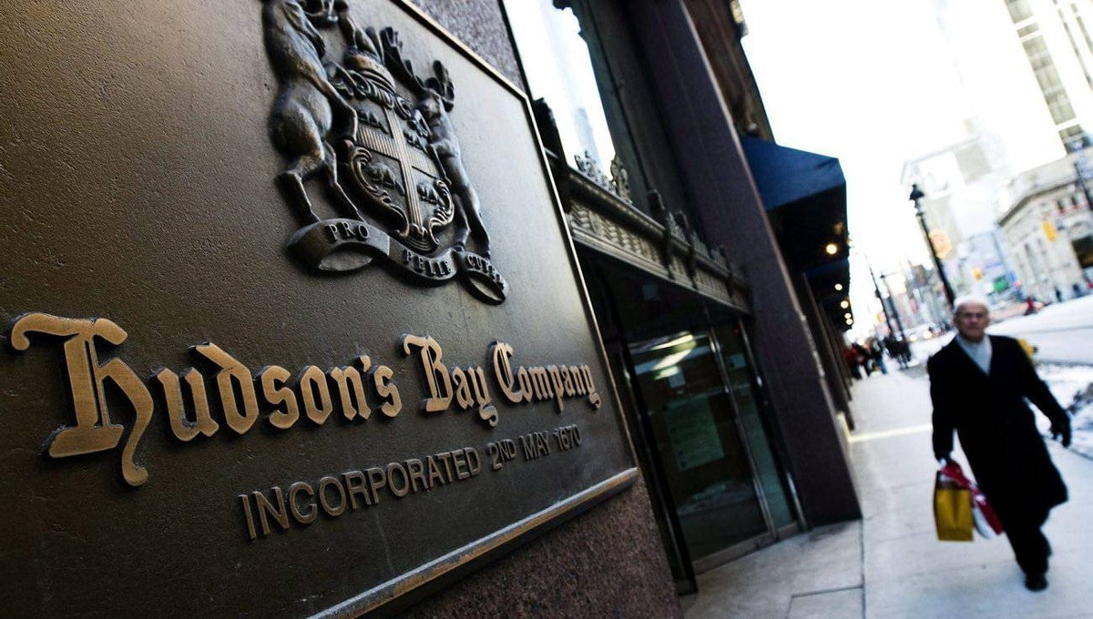 A man walks past the Hudson's Bay Company sign in downtown Toronto.