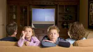 Family watching television, children facing away from television