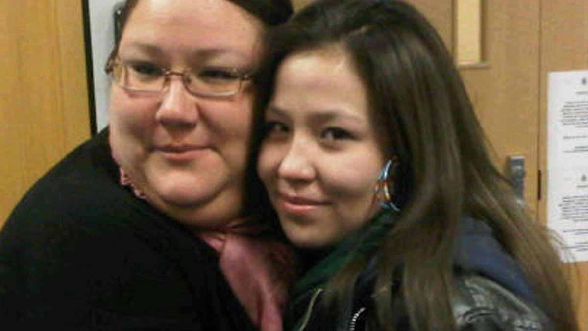 Angel Wolfe, 18, and her stepmom Bridget Perrier embrace outside the Pickton inquiry hearing room after Angel read out an emotional statement that left many people in the public gallery in tears.