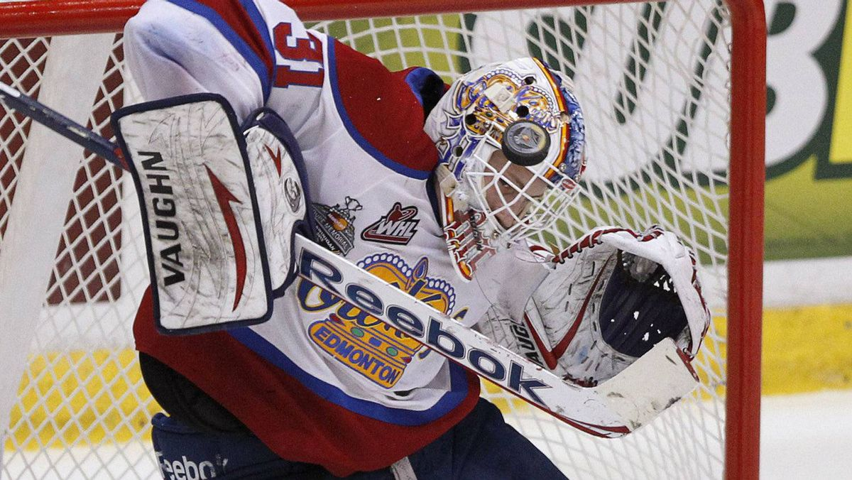 Edmonton Oil Kings goalie Laurent Brossoit makes a save against the Shawinigan Cataractes during the first period of their round-robin Memorial Cup ice hockey game in Shawinigan, Quebec May 18, 2012.