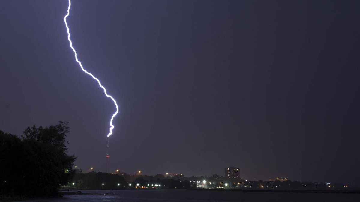 Lightning strikes the CN Tower in Toronto during a fierce thunderstorm on Aug. 24, 2011.