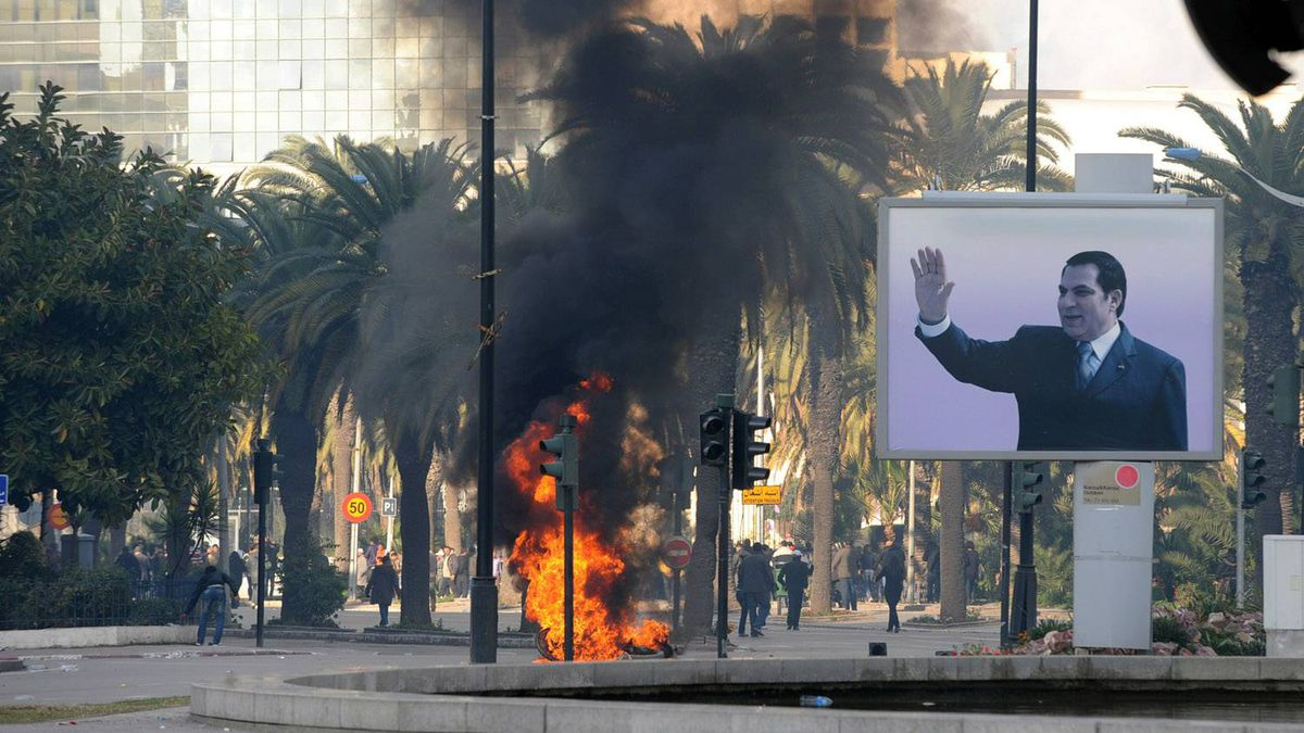 Smoke rises from fire left after clashes between security forces and demonstrators in Tunisia on Jan. 14, 2011 after Tunisian President Zine El Abidine Ben Ali's address to the nation.