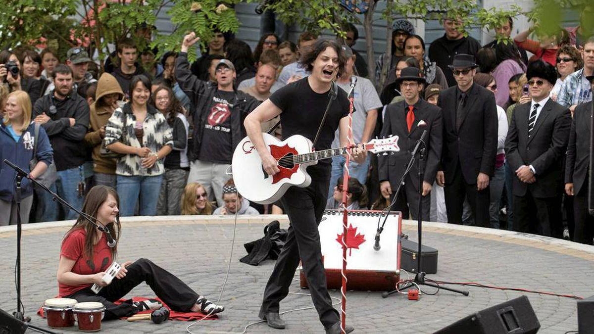 Musicians Jack White and Meg White of the rock band The White Stripes perform an impromptu concert in Whitehorse, Yukon, in 2007.