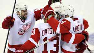 Detroit Red Wings left wing Tomas Holmstrom (L) celebrates his third period game winning goal against the San Jose Sharks with teammates Pavel Datsyuk (13) and defenseman Nicklas Lidstrom (5) during Game 5 of the NHL Western Conference semi-final hockey playoff in San Jose, California May 8, 2011.