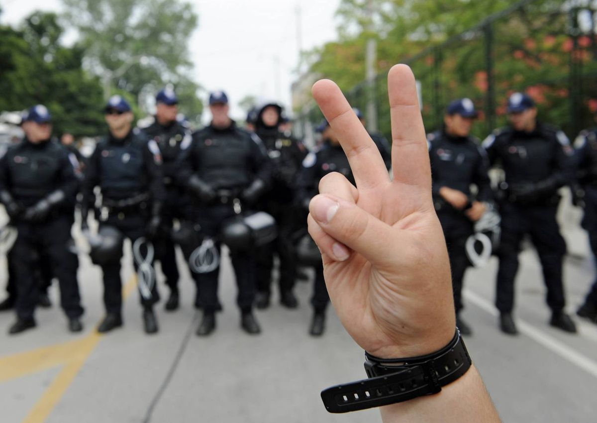 An anti-G20 protester flashes a peace sign near the temporary detention centre in Toronto on June 27, 2010.