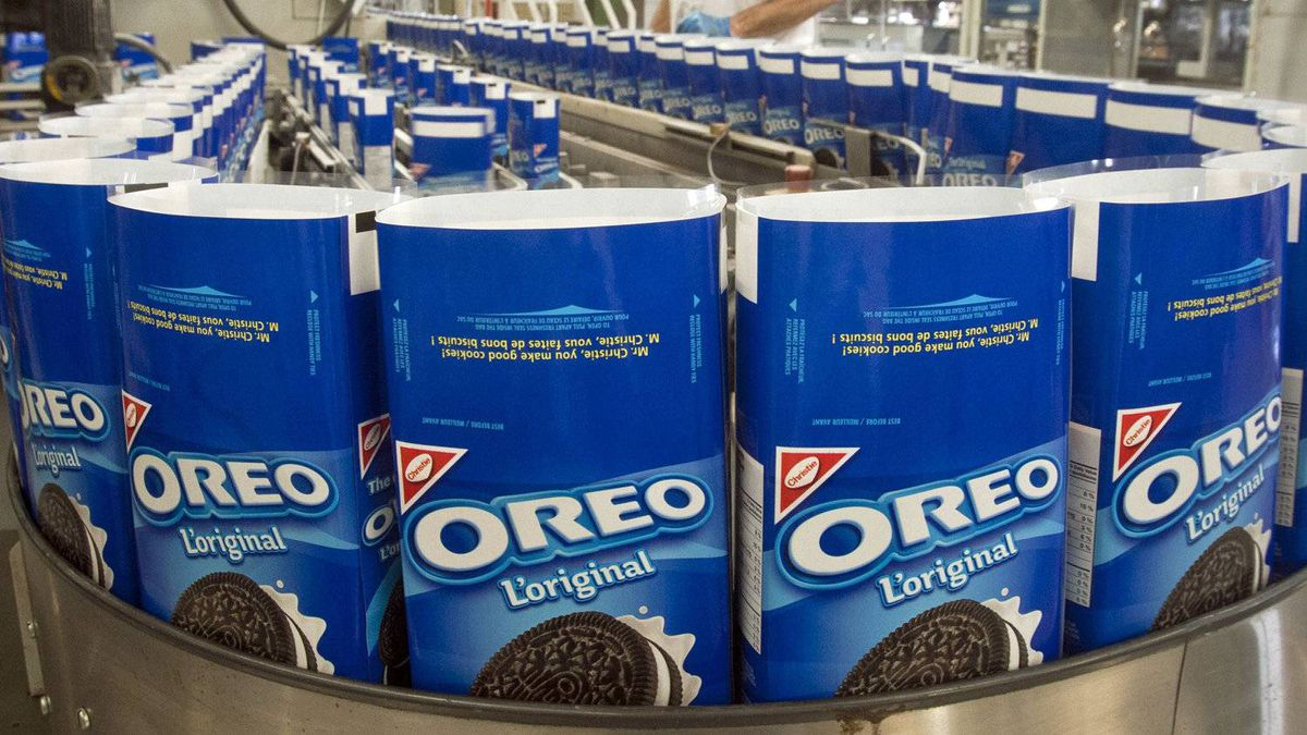 Packages of Oreo cookies snake along a producution line at a Kraft Canada plant in Montreal on Feb. 29, 2012,