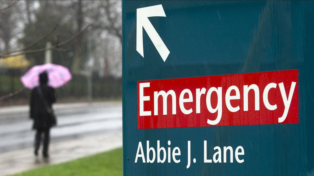 A woman heads past the Halifax Infirmary in Halifax on Tuesday, April 24, 2012.