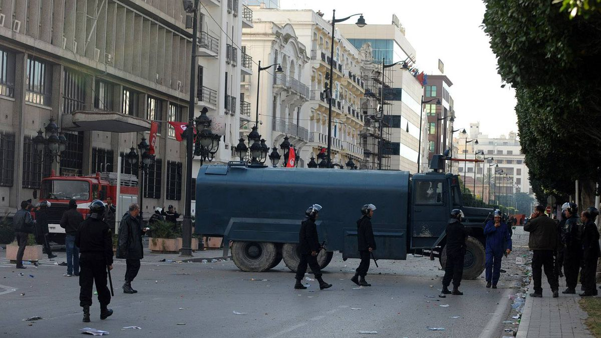 Tunisian security forces personnel block the road during clashes with demonstrators in Mohammed V avenue in Tunisia after Tunisian President Zine El Abidine Ben Ali's address to the nation on Jan. 14, 2011.