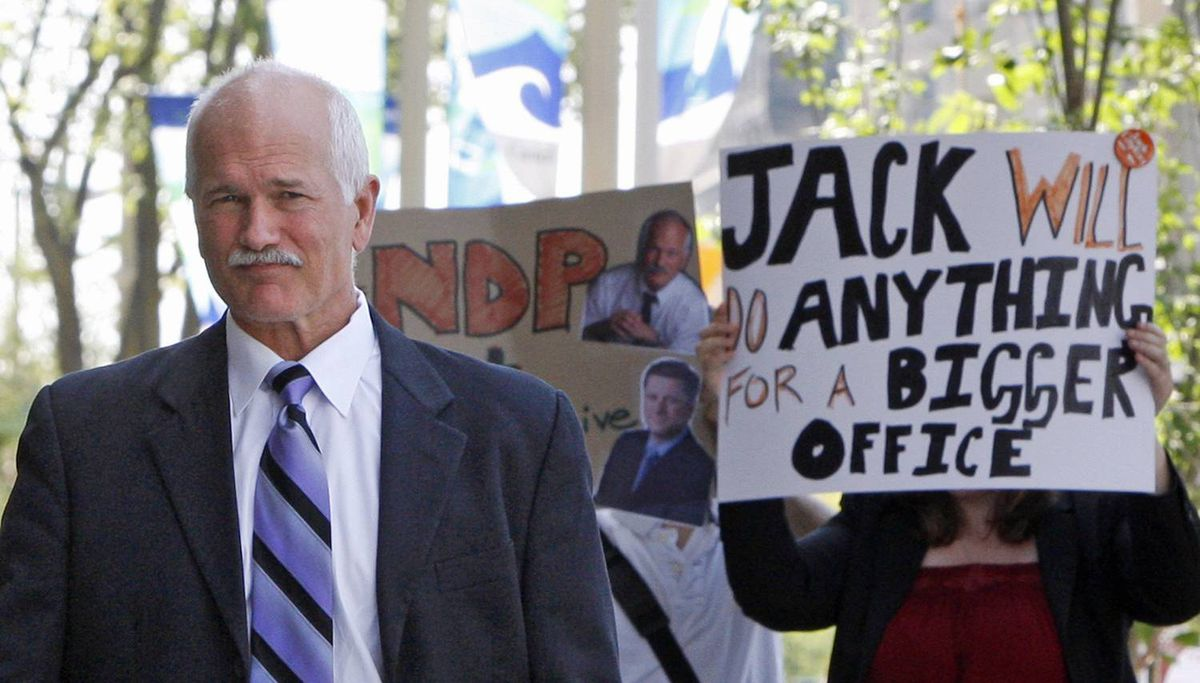 Protestors follow NDP Leader Jack Layton as he arrives at the Langevin Block to meet with Prime Minister Stephen Harper on Aug. 25, 2009.