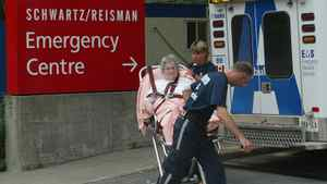 Toronto EMS paramedics bring a patient into emergency at Mount Sinai Hospital in Toronto on Aug. 15, 2003.