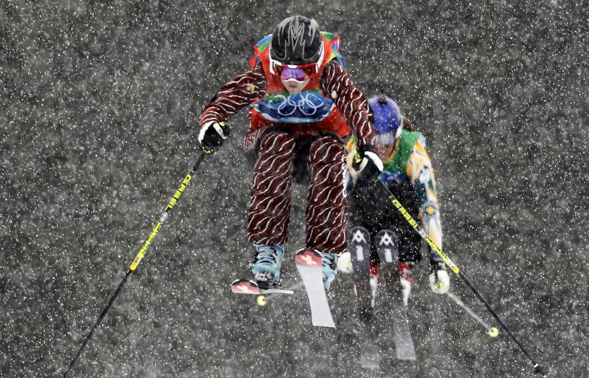 Canada's Ashleigh McIvor, left, leads Australia's Jenny Owens during their quarter-finals run in the women's ski cross on Cypress Mountain at the Vancouver 2010 Winter Olympics, February 23, 2010.