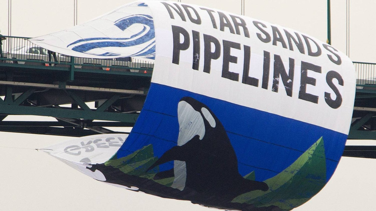 Greenpeace activists hang a large banner off the Lions Gate bridge in Vancouver, B.C. Tuesday, May 29, 2012. The banner is to protest the tar sands and the expansion of the oil pipelines.