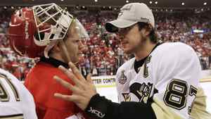 Pittsburgh captain Sidney Crosby shakes hands with Detroit Red Wings goalie Chris Osgood after the Penguins won the Stanley Cup.