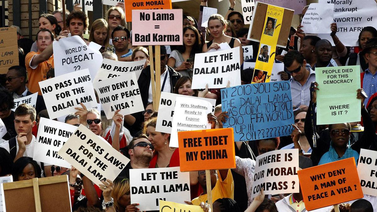 Wits University students and lecturers hold placards as they take part in a public march to protest the cancellation of the Dalai Lama's visit to South Africa, in Johannesberg October 5, 2011.