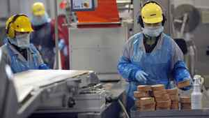 Workers man production lines at Maple Leaf Foods in Toronto on Dec. 15, 2008.