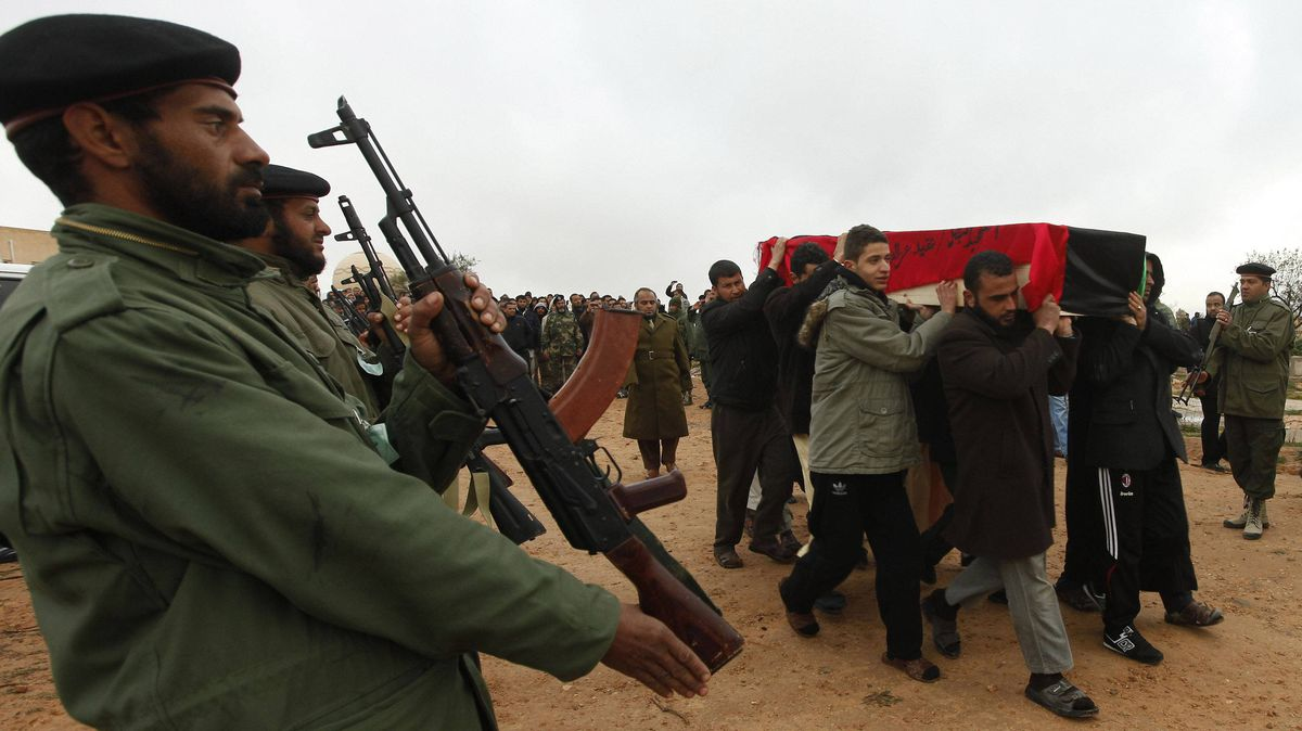 A funeral is held in the Libyan town of Assabia for military commander Ezzedine al-Ghool, who was reportedly tortured to death by fighters in Gharyan, a rival city, Jan. 19, 2012.