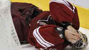Phoenix Coyotes' Mike Smith falls to the ice after being hit during action against the Chicago Blackhawks during the second period of Game 2 of the first round of the Western Conference Quarter-finals Saturday, April 14, 2012 in Glendale. Chicago won 4-3 in overtime. (AP Photo/David Kadlubowski, The Arizona Republic)