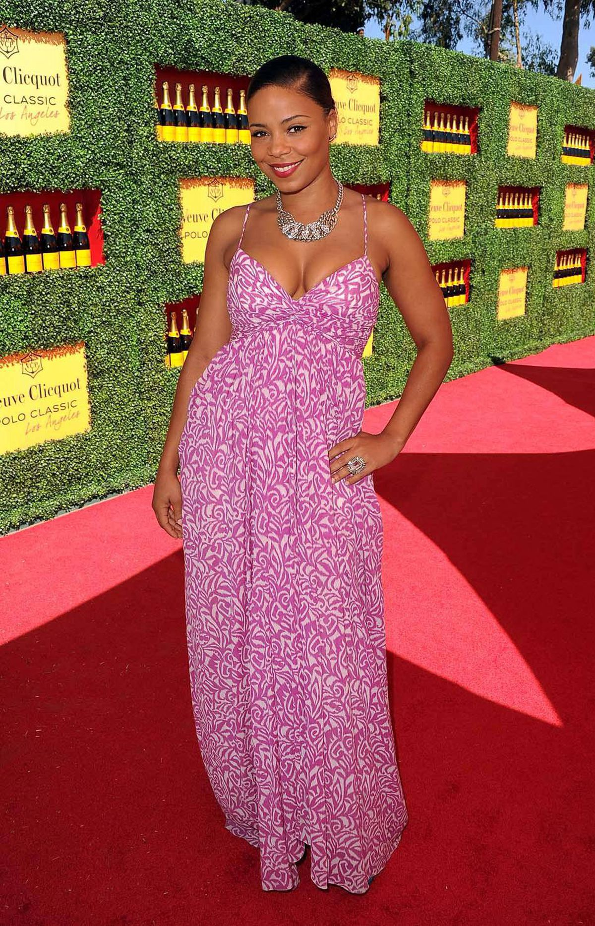 """Clearly outraged by the excessive bonuses paid to Wall Street executives, actress Sanaa Lathan defines unostentation at the champagne-sponsored event for the elitest equestrian game sometimes known as """"The Sport of Kings"""" in Los Angeles on Sunday."""