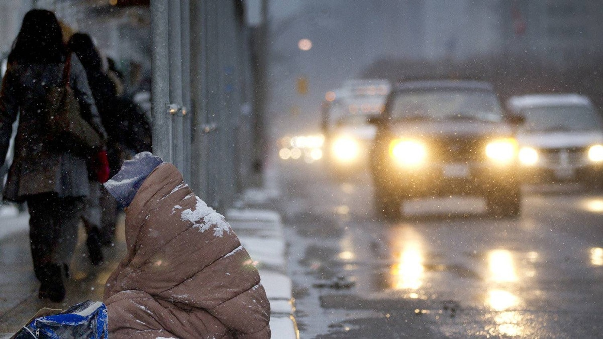 Pedestrians bundled up agains the cold in Toronto in this March 23, 2011 file photo.