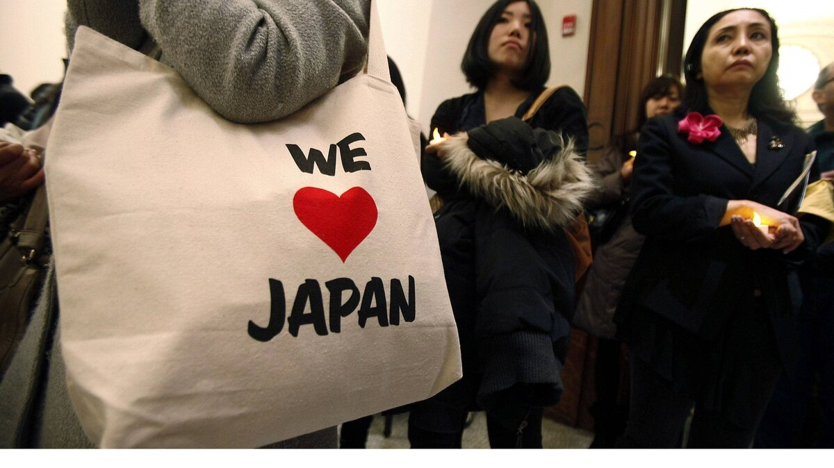 Members of the Japanese community gather in New York on Saturday night for a vigil to mark the first anniversary of the Japanese tsunami.
