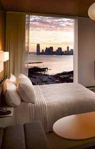 ENJOY THE VIEW The rooms offer sweeping views of the Hudson River through floor-to-ceiling windows. The lesson: Even small spaces seem much bigger if you take advantage of views. Watching the sunset is like experiencing live theatre – but draw the curtains afterward, or you'll be the one giving a show.