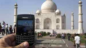 A BlackBerry is used to take a photo of the Taj Mahal Thursday, October 14, 2010 in Agra, India.