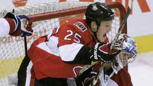 The Ottawa Senators' Chris Neal (L) knocks the Montreal Canadiens' goaltender Carey Price after scoring during the first period of their pre-season NHL hockey game at Scotiabank Place in Ottawa, September 25, 2010. REUTERS/Patrick Doyle
