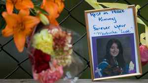 A photo of Kimberly Proctor, an 18-year-old from Langford whose burned body was found Friday at Millstream Creek beneath the Galloping Goose Trail along the Langford-Colwood border, sits at a memorial near the location she was discovered.