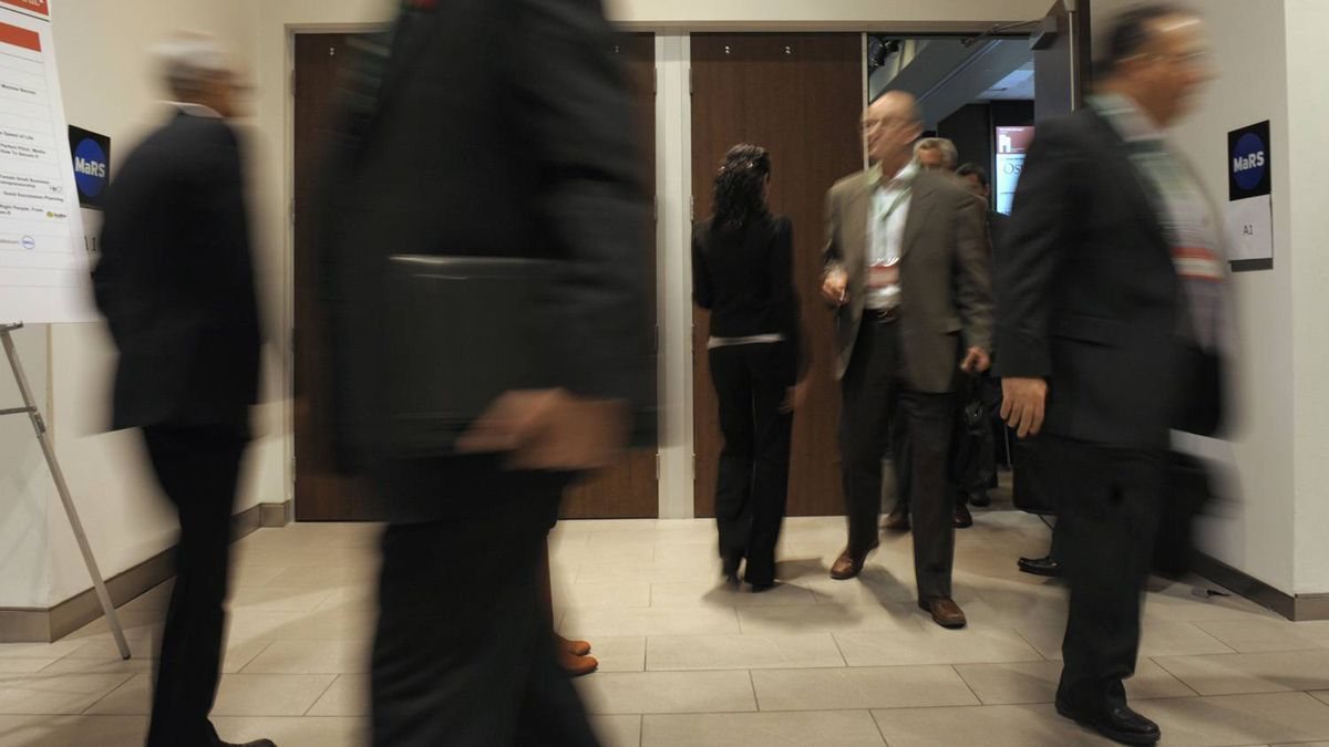 Attendees wait to enter a room for a workshop at the Small Business Summit at the MaRS Discovery District in Toronto on Nov. 8, 2011.