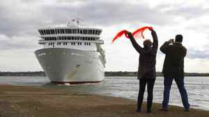 People wave at the MS Balmoral cruise ship as it leaves for the Titanic memorial cruise from Southampton, England, Sunday, April 8, 2012.