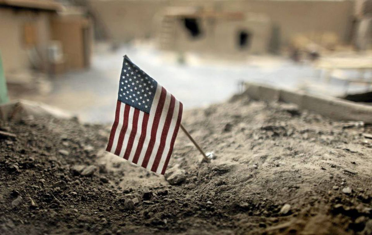 An American flag is placed in a dirt-filled barrier outside the headquarters of 3rd Platoon, 1-320 Field Artillery Regiment, 101st Airborne Divivion, at Combat Outpost Nolen in the Arghandab Valley north of Kandahar.