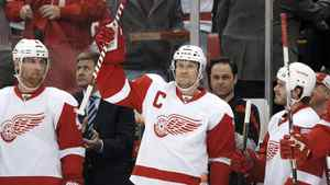 Detroit Red Wings defenseman Nicklas Lidstrom, center, of Sweden, acknowledges the crowd in the first period of an NHL hockey game against the Philadelphia Flyers in Detroit, Sunday, Feb. 12, 2012.