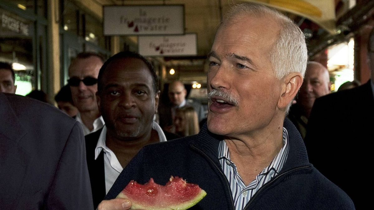 NDP Leader Jack Layton eats watermelon during a campain stop at the Atwater Market in Montreal Sunday, May 1, 2011