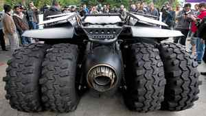 """People take photos and gather around the Batmobile from the upcoming Batman movie """"The Dark Knight Rises"""" at Electronic Arts in Burnaby, B.C., on Tuesday April 17, 2012."""