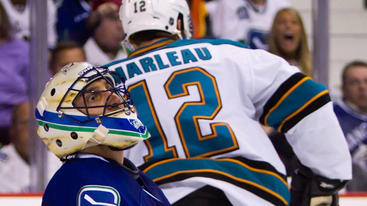 Vancouver Canucks' goalie Roberto Luongo reacts after San Jose Sharks' Patrick Marleau, back, scored during the second period. THE CANADIAN PRESS/Darryl Dyck