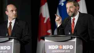 NDP leadership candidate Thomas Mulcair, right, makes a point as fellow candidate Nathan Cullen looks on during an NDP leadership debate in Montreal on March 4, 2012.