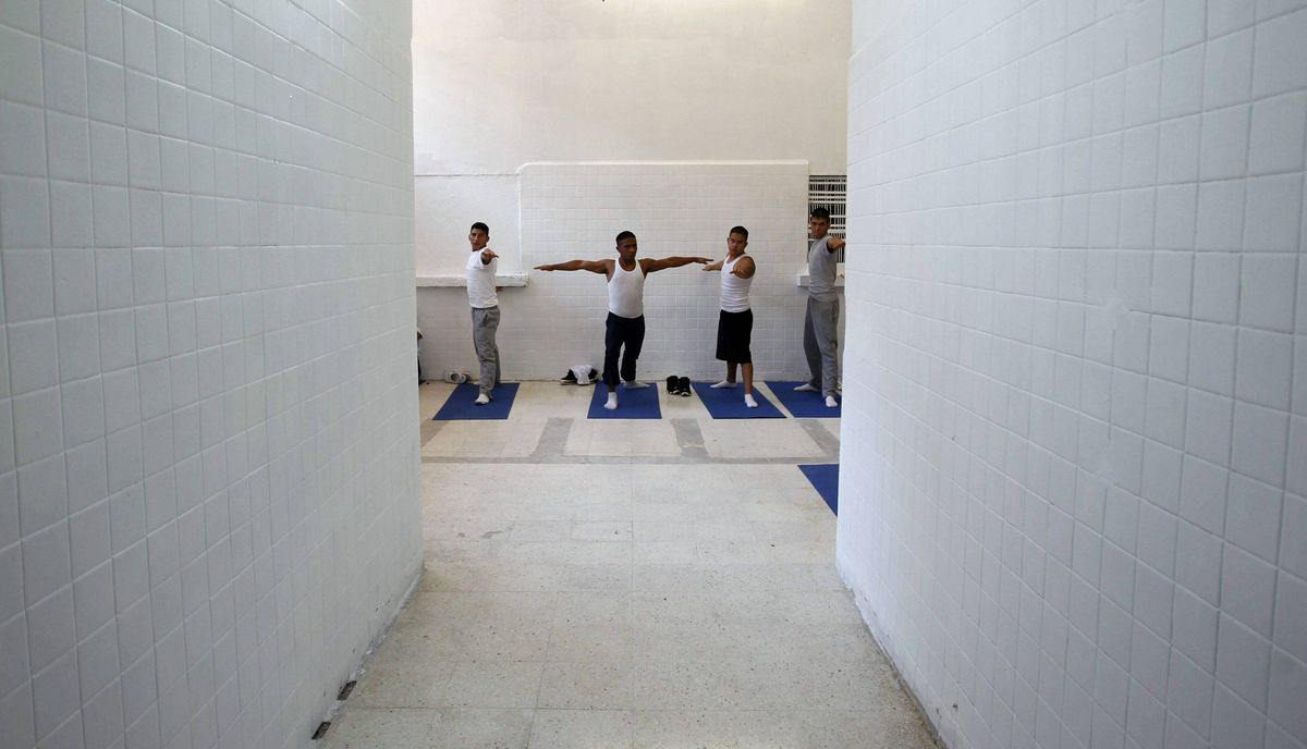 Inmates practice yoga during class inside a juvenile detention centre in Mexico City November 16, 2011.