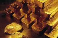 Gold nuggets and bars are shown in this file photo.