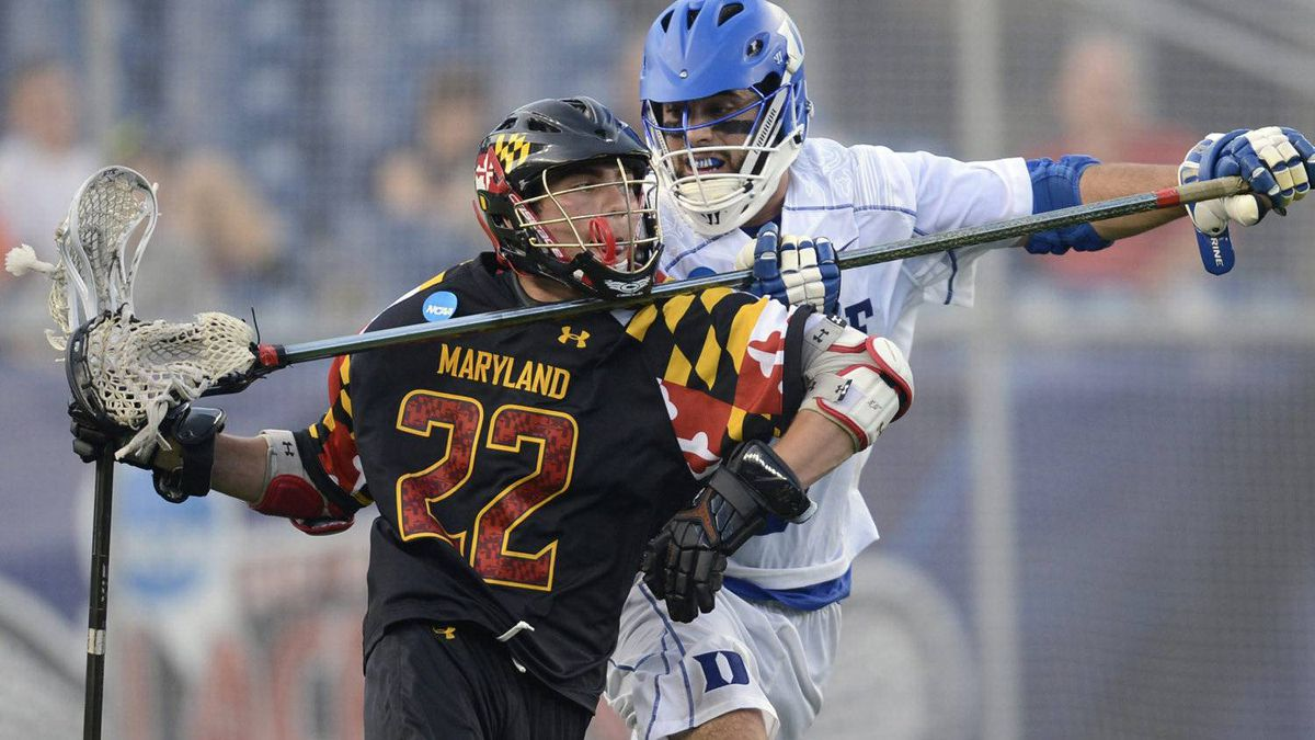 Maryland's Sean McGuire, left, tries to get past the reach of Duke's Michael Manley during the fourth quarter of an NCAA Division I men's lacrosse semi-final in Foxborough, Mass., Saturday, May 26, 2012. Maryland won 16-10. (AP Photo/Gretchen Ertl)