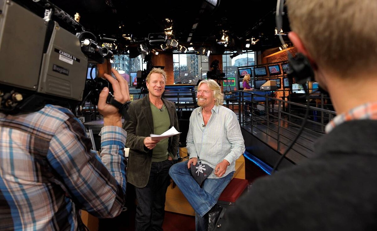 CP24 Breakfast Show host Steve Anthony (left) talks with Sir Richard Branson during an appearance on the CP24 Breakfast Show.