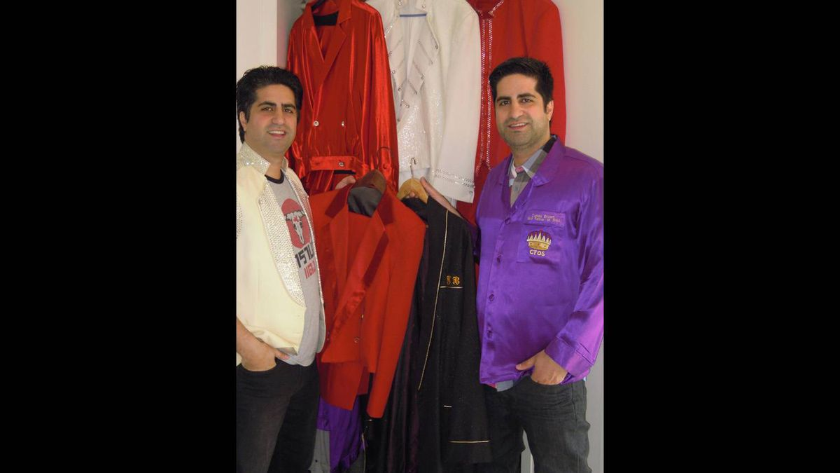 Page, left, and Jian Magen, co-owners of Magen Boys Entertainment, with some of the James Brown clothing they purchased at auction