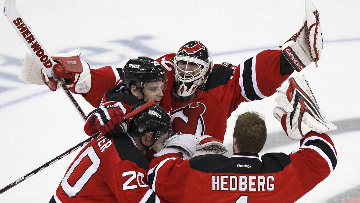 New Jersey Devils goalie Martin Brodeur (C) celebrates with teammates Anton Volchenkov, Ryan Carter (20) and Johan Hedberg (1) after the Devils defeated the New York Rangers in Game 6 of their NHL Eastern Conference Final game in Newark, New Jersey, May 25, 2012.