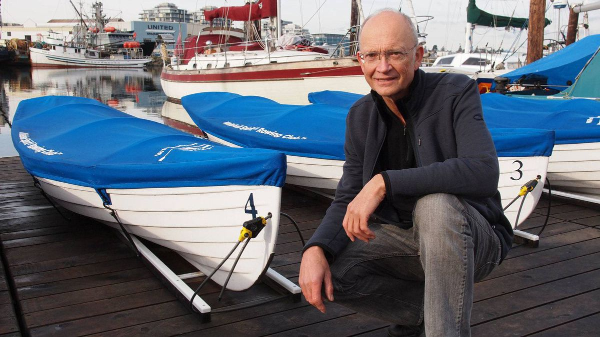 Harold Aune with his company's rowing skiffs.