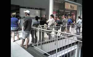 Customers queue up for the iPhone 4 at Toronto's Eaton Centre, Wednesday morning, Aug. 11, 2010.
