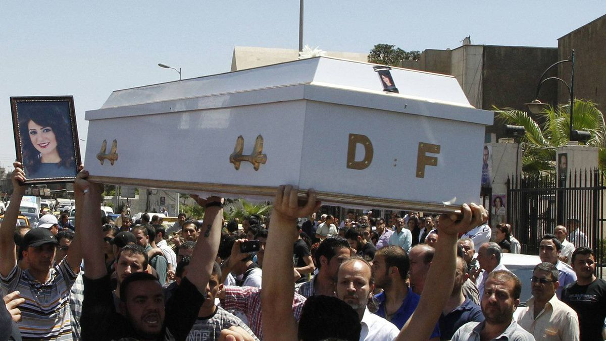 Mourners carry the coffin of Dima Farah, who was killed in Thursday's suicide bomb attack, during her funeral at the Mar Elias monastery in Damascus May 12, 2012. A video posted online in the name of a shadowy militant group is claiming responsibility for the twin suicide bombings in the Syrian capital this week that killed 55 people.