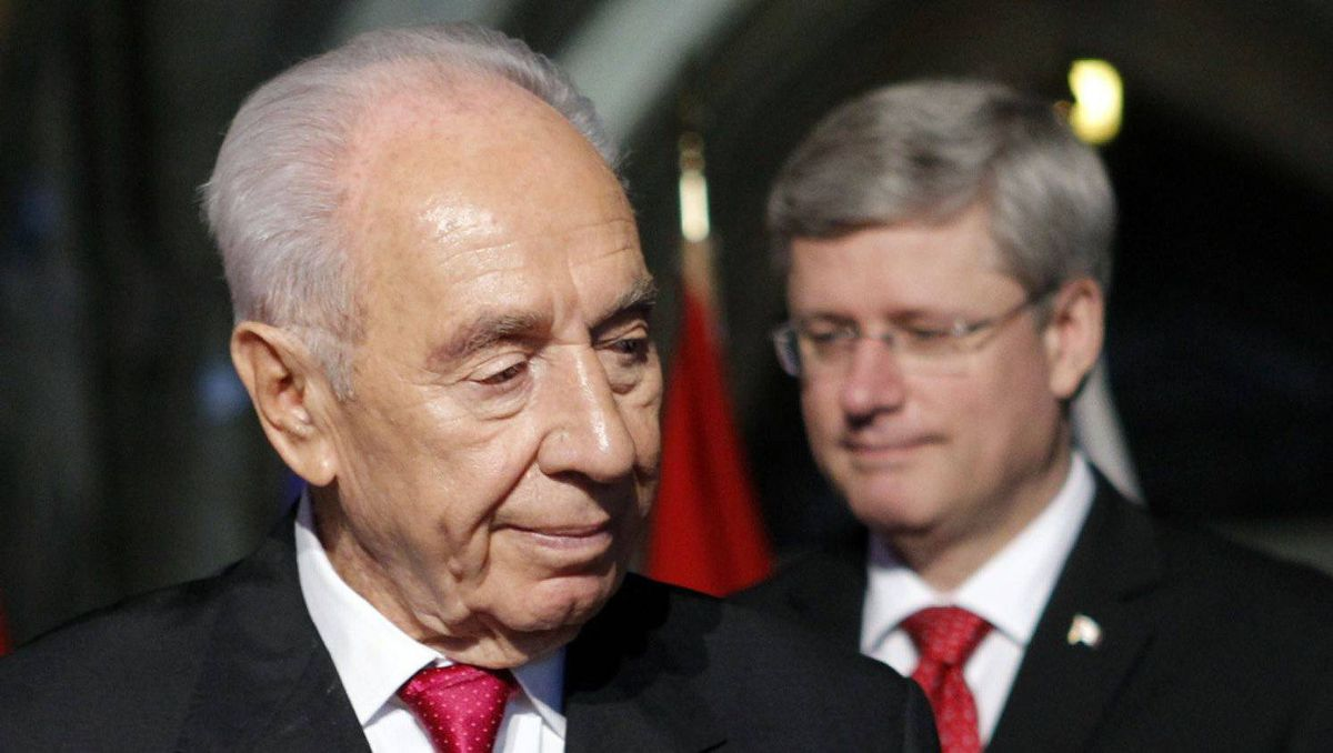 Shimon Peres and Prime Minister Stephen Harper take part in a welcome ceremony for the Israeli President in Parliament's Centre Block on May 7, 2012.