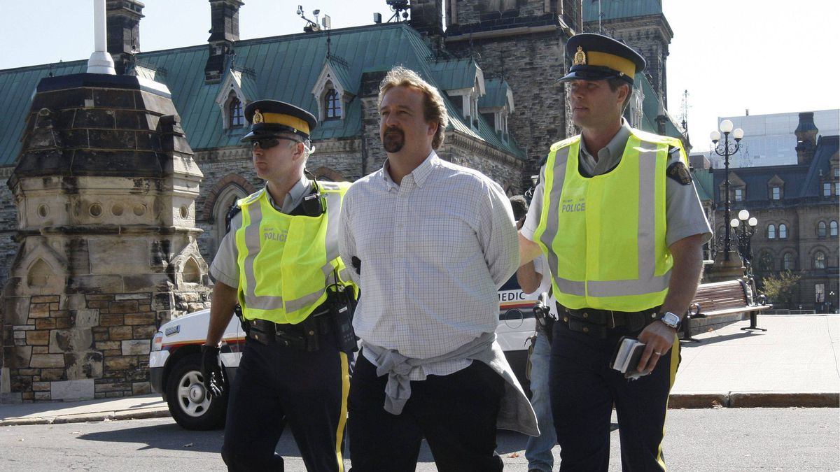 Police escort a protester at a rally against the Keystone XL pipeline on Parliament Hill in Ottawa on Monday Sept. 26, 2011.